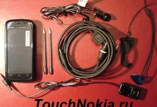 И так что у нас в коробке Nokia 5800.....